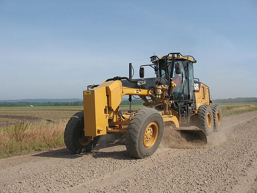 Pope County Road Department Road Grader grading road