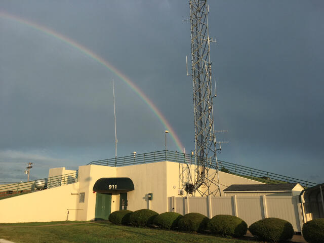 911 Center with a rainbow leading to it